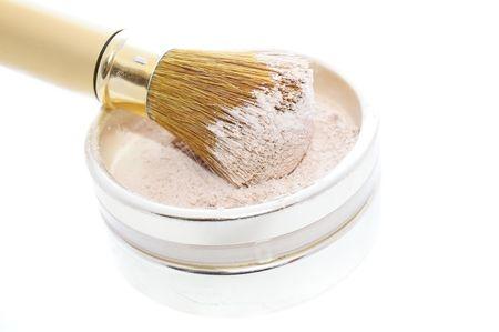 Makeup Powder and Brush on White Background photo