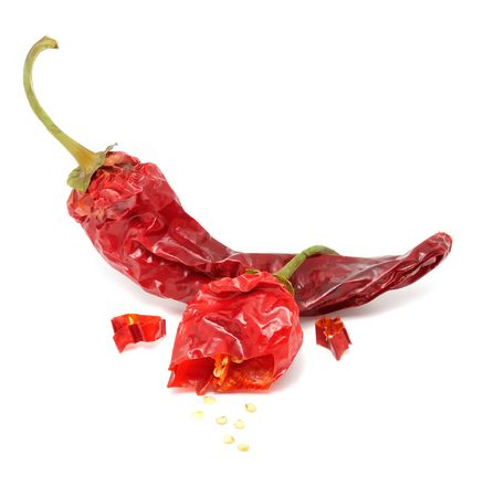 capsaicin: Dried Hot Chili Peppers Isolated on White Background