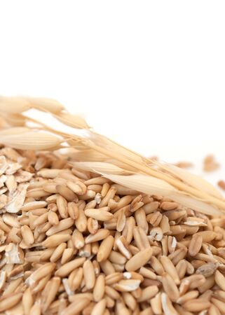 starchy food: Whole Oats on White Background