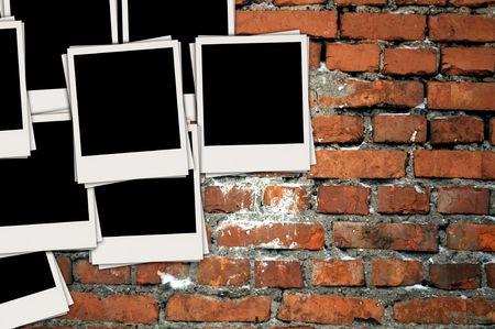 Pile of Blank Photos on Brick Wall photo