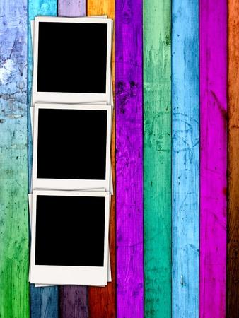 pics: Three Blank Photos on Wood Background