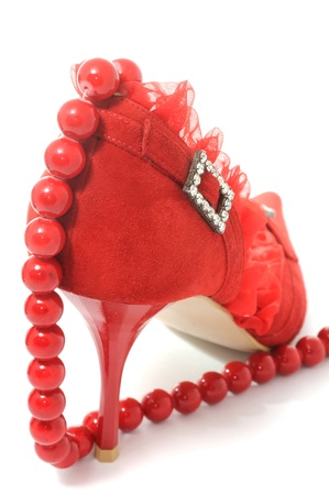 Sexy Red Female Shoe And Beads Isolated on White Background photo