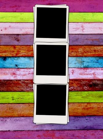 Blank Photos on Multicolored Wood Background photo