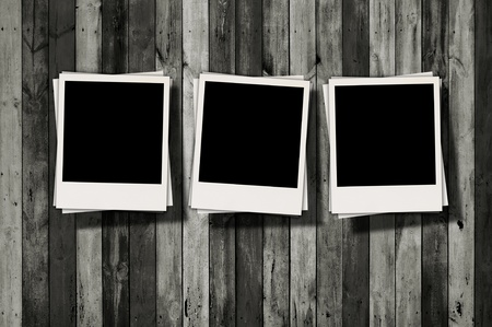 pic  picture: Three Blank Polaroids on Dark Wood Background