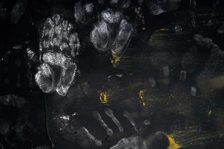hooligan: Handprints on Dark Background