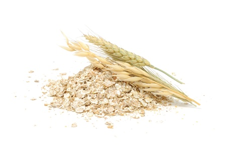 Wheat, Oat And Rye Flakes with Ears Isolated on White Background photo