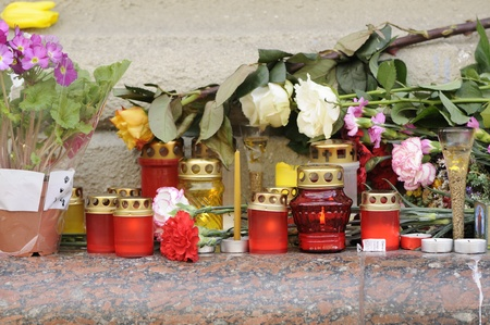 MINSK, BELARUS - APRIL 12, 2011: Burning candles and flowers near Oktyabrskaya metro station after a terrorist attack on April 11, 2011 in Minsk, Belarus