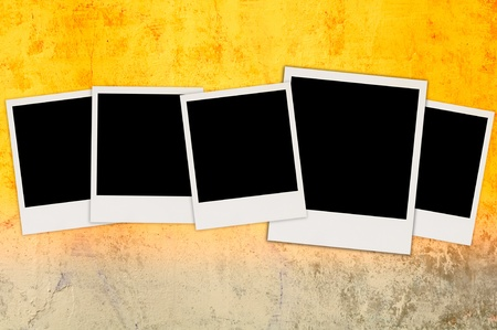 Five Blank Photos on Bright Concrete Wall Stock Photo - 9463805