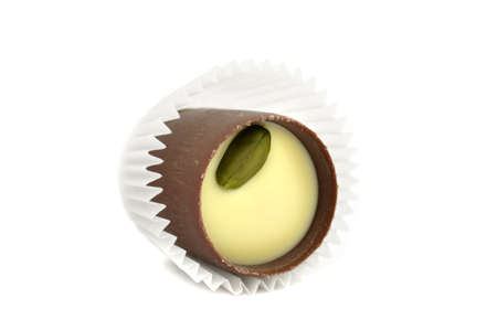 Dainty Chocolate Sweet with Pistachio Isolated on White Background photo