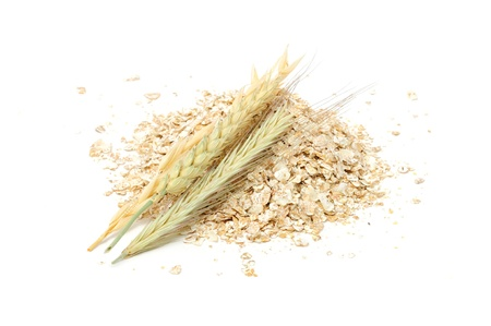 Wheat, Oat, Barley And Rye Flakes with Ears Isolated on White Background photo