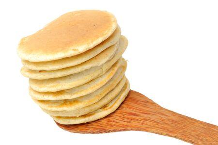 Pancakes on Spatula on White Background photo