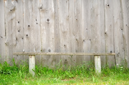 Old Bench Against Wooden Wall photo