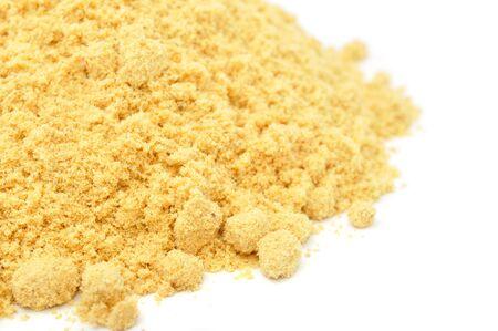 Ground Mustard Close-up on White Background photo