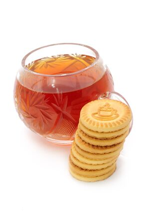 Cup of Tea and Cookies Isolated on White Background photo