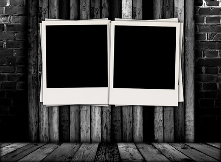 Two Blank Photos in Dark Room photo