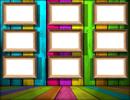 Nine Blank Frames in Multicolored Wooden Room photo