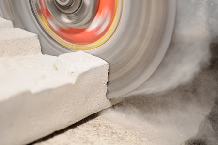 concrete blocks: Grinder Cutting Concrete Block