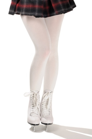 Legs of Figure Skater in White Ice Skates photo