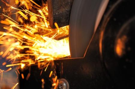 sharpening: Sparks from Grinder in Workshop
