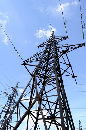 power line tower: Electricity Pylon and Power Lines on Blue Sky Background