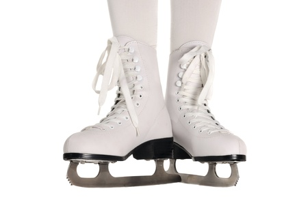 Woman Legs in White Ice Skates on White Background photo