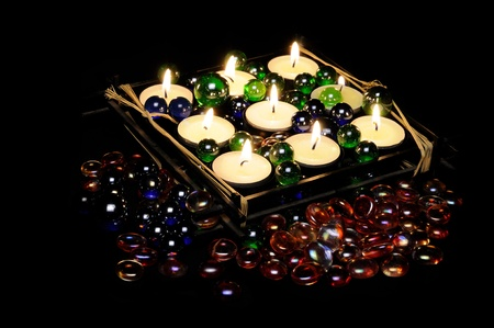 Burning Romantic Candles in Candle Holder with Decorative Glass Stones photo