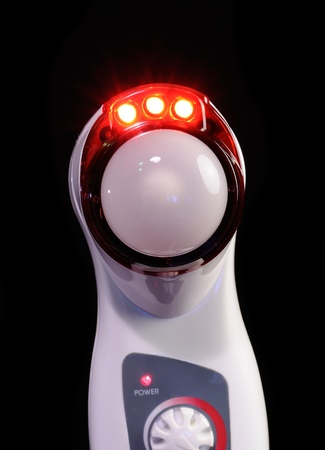 light complexion: Darsonvale - High Frequency Skin Care Device with Infrared Light on Black Background Stock Photo