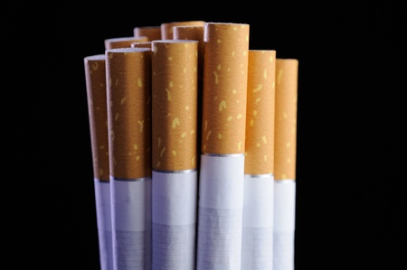 lifespan: Bunch of Cigarettes on Black Background
