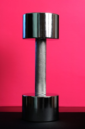 Shiny Metal Dumbbell on Pink Background Stock Photo - 11622539