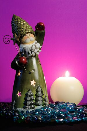 Santa Claus and Burning Candle on Magic Purple Background Stock Photo - 11610422