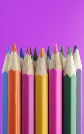 Colored Pencils on Bright Purple Background Stock Photo - 11622715