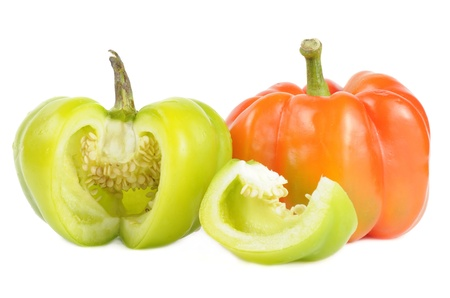 Red and Cut Green Bell Peppers Isolated on White Background photo