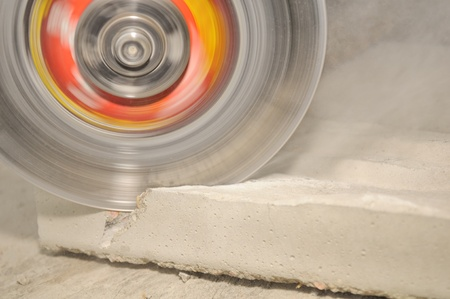 Grinder Cutting Concrete Block photo