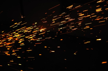 Glowing Flow of Sparks in the Dark photo