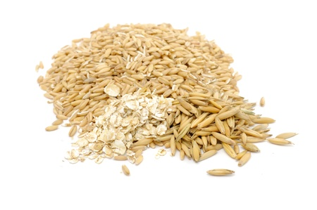 whole grains: Whole Peeled Oats, Oat Flakes and Unpeeled Oats Isolated on White Background Stock Photo