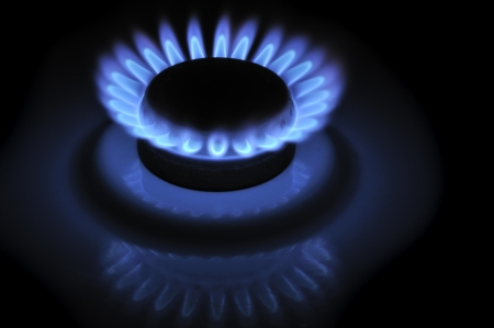 gas burner: Blue Flames of Gas in the Dark Stock Photo
