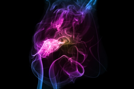 swirling: Clouds of Multicolored Smoke on Black Background Stock Photo
