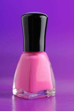 Pink Nail Polish on Purple Background Stock Photo - 12335887