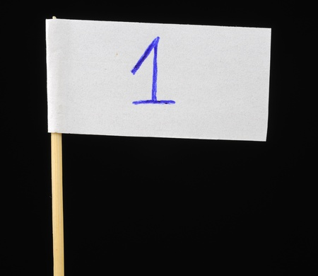 Handwritten Number One on Paper Flag on Black Background photo