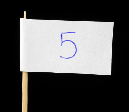 Handwritten Number Five on Paper Flag on Black Background photo