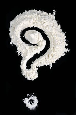 Question Mark Written in Flour on Black Background photo