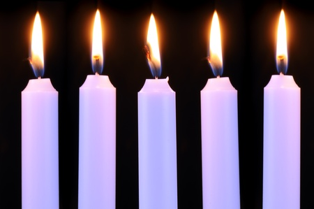 evening glow: Five Burning Candles on Black Background