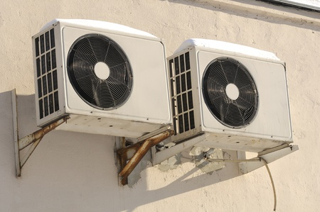 mechanical ventilation: Outdoor Units of Air Conditioner on the Wall Stock Photo