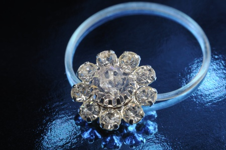 fake diamond: Toe Ring on Black Background