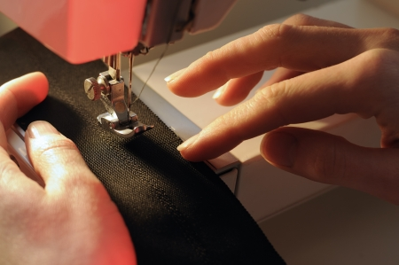 Tailor at Work on Sewing Machine photo