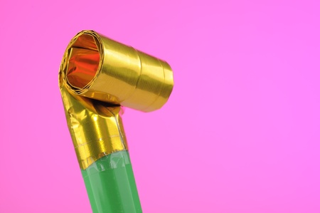 Party Noise Maker on Pink Background Stock Photo - 12511002
