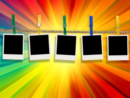 pic: Blank Photos Hanging on Rope Against Multicolored Rays Background