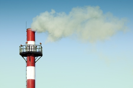emitting: Industrial Smokestack Emitting Smoke into the Sky Stock Photo