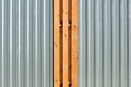 fence panel: Metal Fence with Wood Inserts Stock Photo