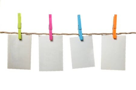 photograph: Old Blank Photos Hanging on Rope on White Background